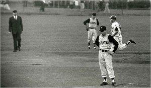 Harvey Haddix with Joe Adcock rounding the bases