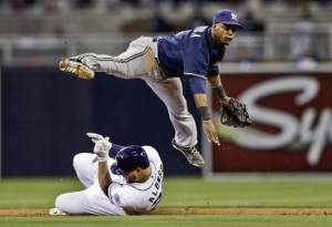 Brewer shortstop Jean Segura turning a double play